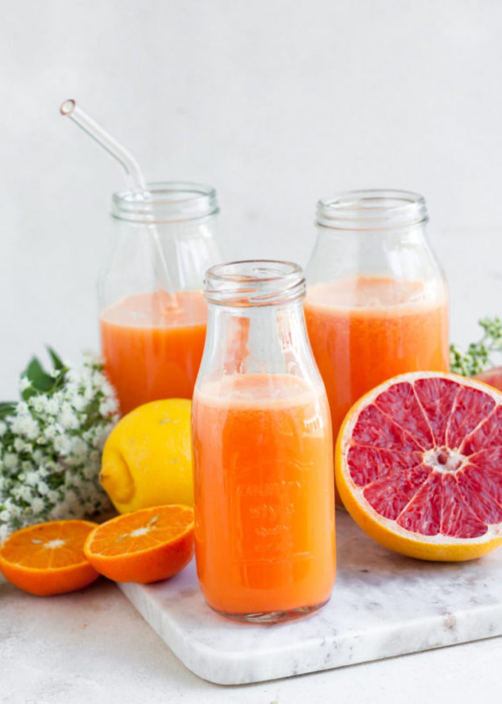 Pompelmoes, wortel, sinaasappel sap